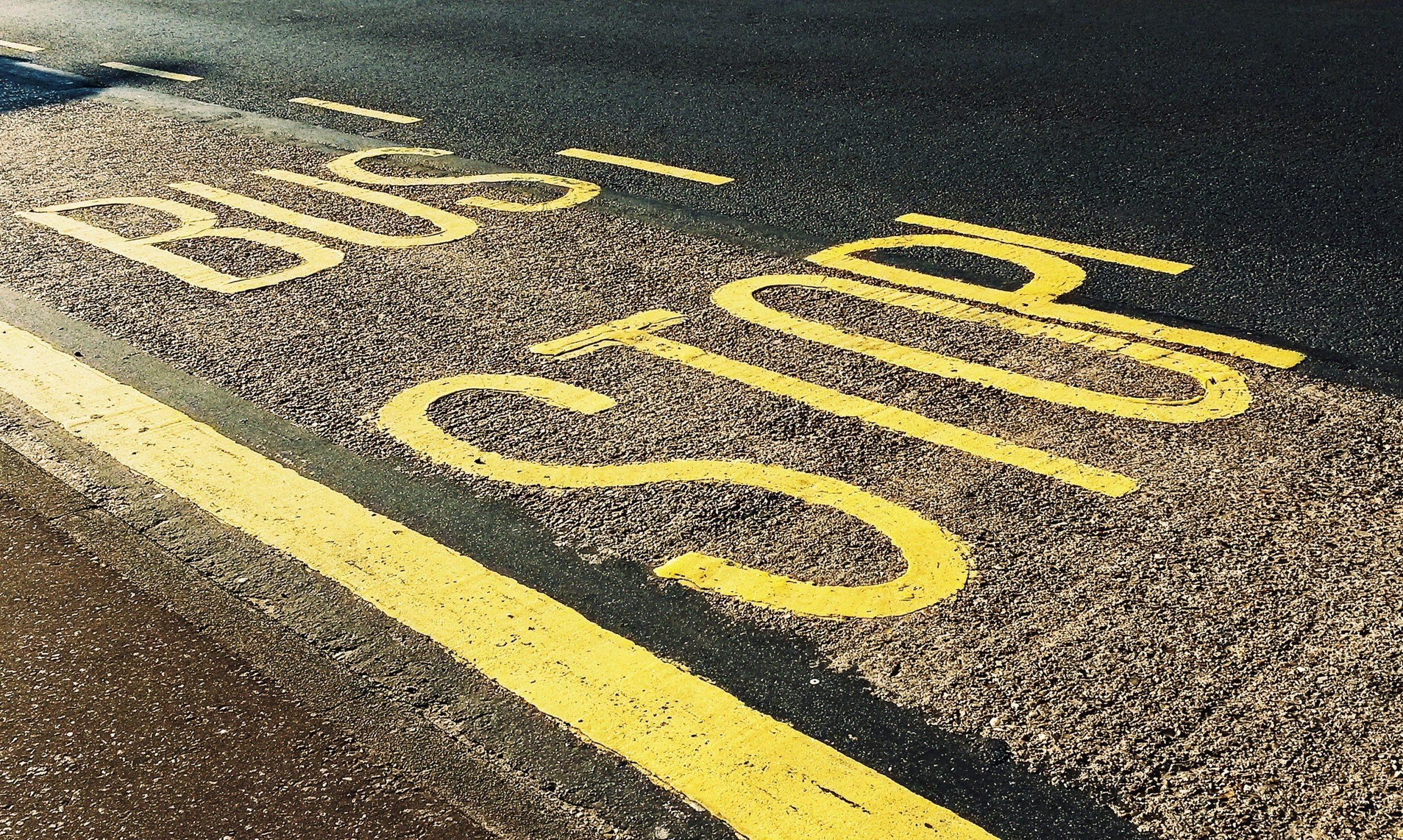 asphalt-bus-stop-close-up-1260437